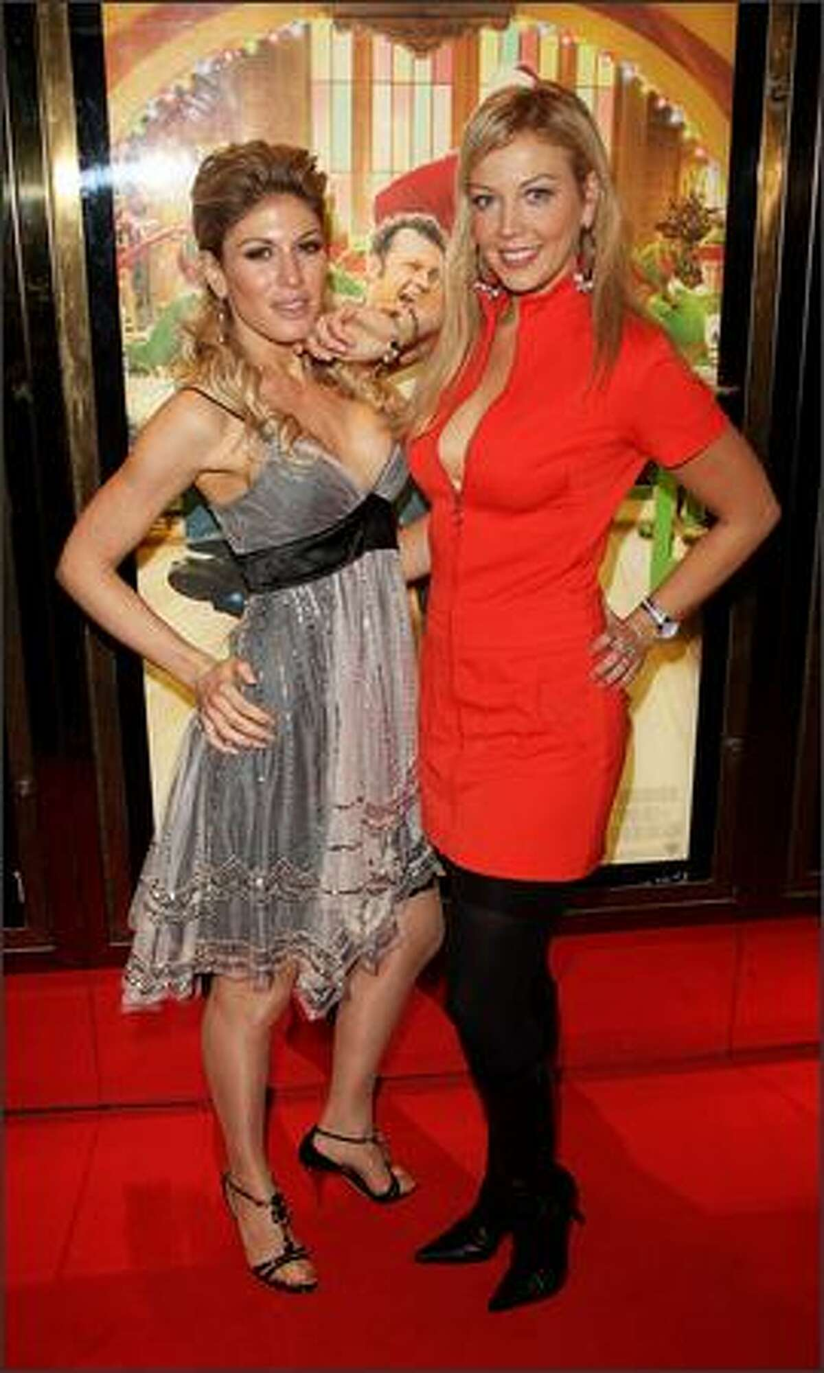 """TV presenter Liz Fuller (R) and model Hofit Golan arrive at the European premiere of """"Fred Claus"""" at the Empire Cinema Leicester Square on Monday in London, England."""