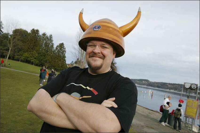 Phil Lacefield Jr., of North Bend, sports a horned hat made of wood before participating in the Sixth Annual Polar Bear Plunge on Tuesday at Matthews Beach Park in Seattle.