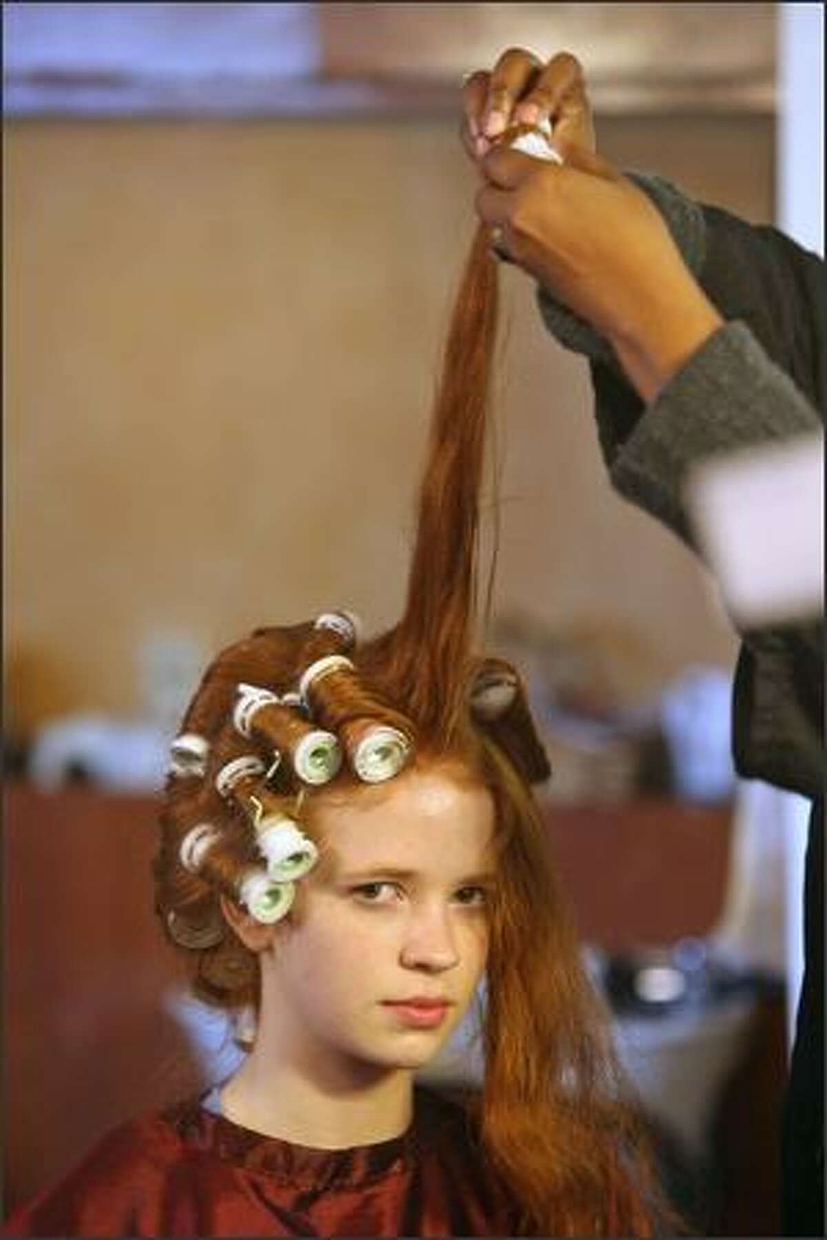 Stylist Kay Matthews gives Claire Nelson's hair a workout before a shoot.