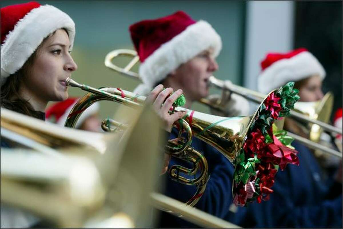 Members of the Mount Rainier High School Ramblin' Band perform during the Macy's holiday parade in downtown Seattle.