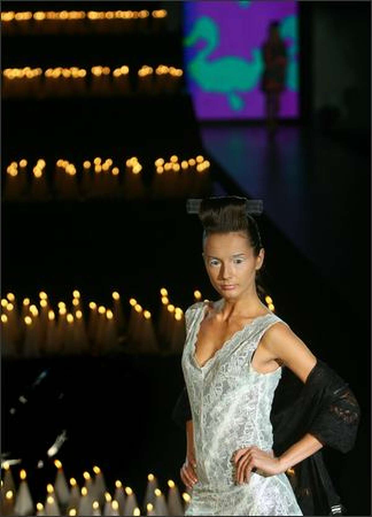 A model displays a creation from ready-to-wear collection by Ukrainian fashion designer Alexksey Zalevskiy during Ukrainian Fashion Week show in Kiev 12 October, 2007.
