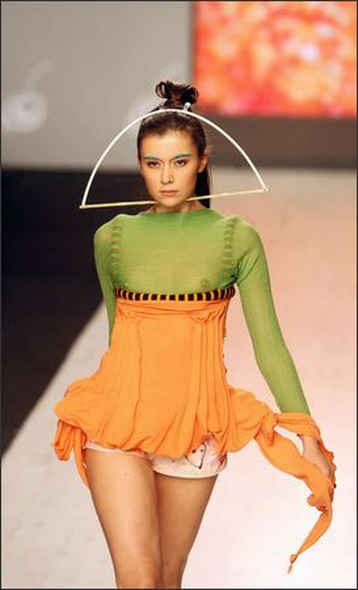 A model displays an outfit by popular fashion designer Elena Burenina as part of the Ready-to-Wear Spring-Summer 2008 collection during the Ukrainian Fashion Week in Kiev, 16 October 2007.