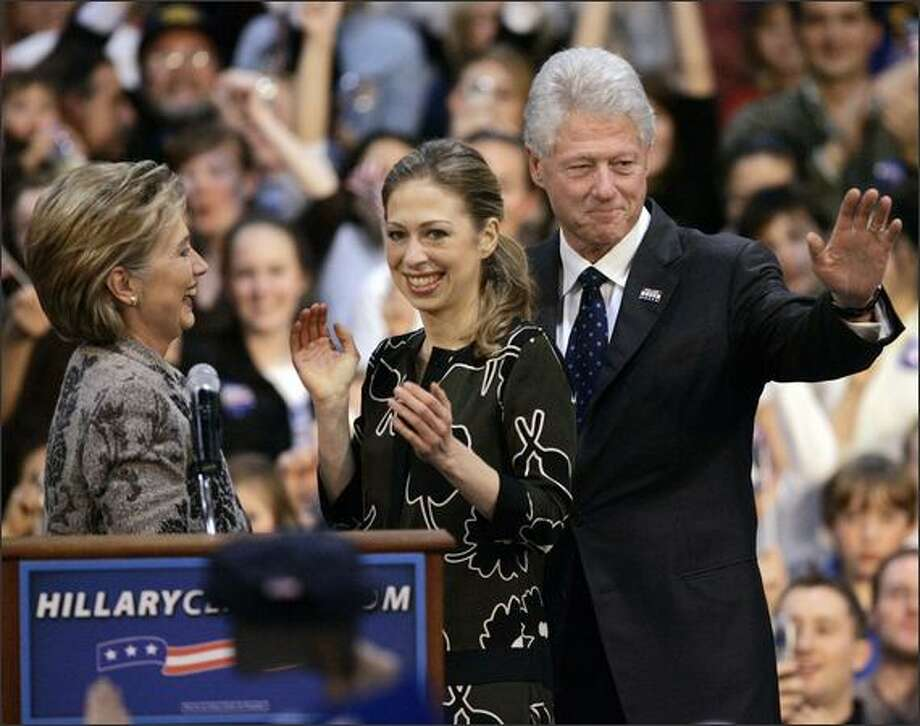 Democratic presidential hopeful Sen. Hillary Rodham Clinton, D-N.Y. reacts with her husband, former President Clinton and daughter, Chelsea at her Democratic primary election night victory rally in Manchester, N.H.  AP Photo/Elise Amendola