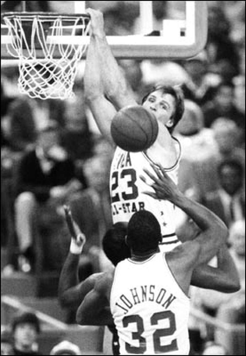 Feb. 8, 1987: Seattle SuperSonic Tom Chambers eyes a missed dunk during the NBA All-Star game at the Dome. Despite missing the dunk, Chambers was named the game's MVP. Magic Johnson (32) stands in the foreground, by the way.