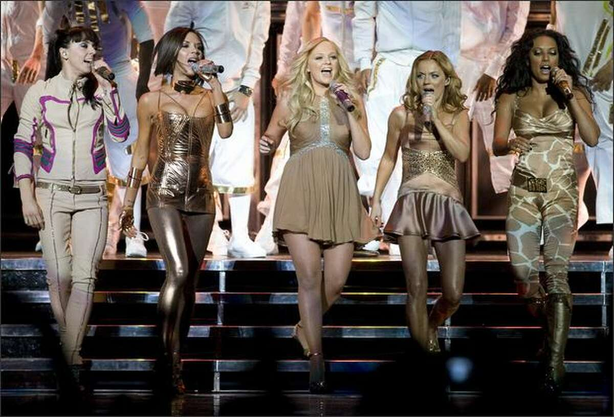 The Spice Girls, from left, Melanie Chisholm, Victoria Beckham, Emma Bunton, Geri Halliwell and Melanie Brown perform at GM Place in Vancouver, B.C. Sunday.