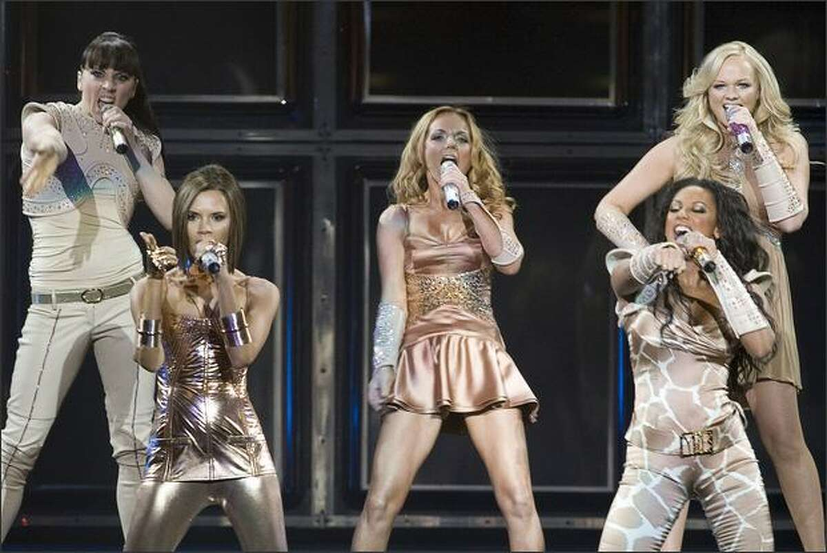 The Spice Girls, from left, Melanie Chisholm, Victoria Beckham, Geri Halliwell, Melanie Brown and Emma Bunton perform at GM Place in Vancouver, B.C. Sunday.