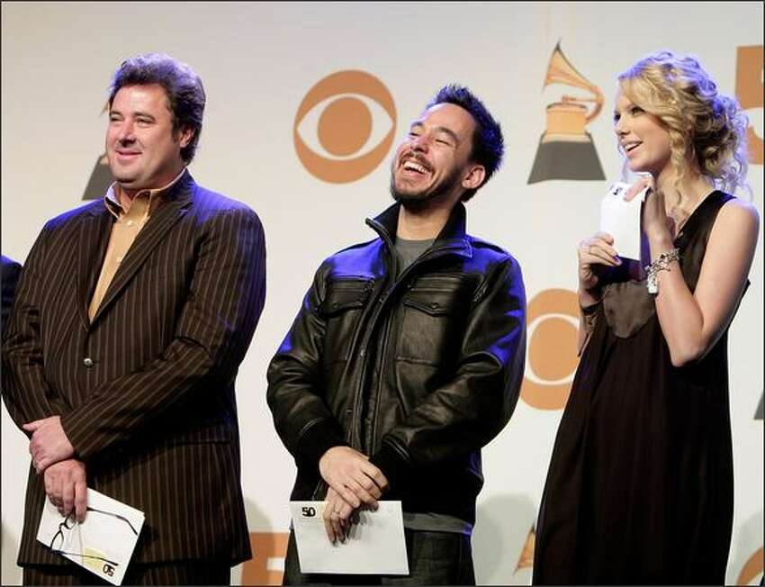 Left to right, Musicians Vince Gill, Mike Shinoda, and Taylor Swift onstage during the 50th annual Grammy Award Nominations held at the Henry Fonda Music Box Theatre on Thursday in Hollywood, Calif. The 50th annual Grammy Awards will air live on CBS Feb. 10, 2008.