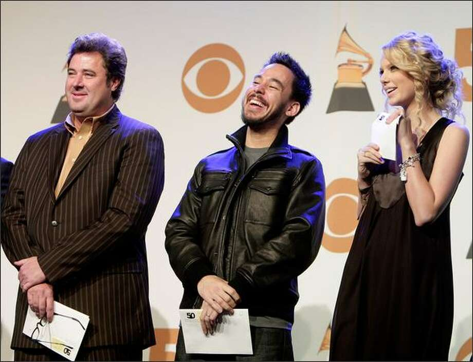 Left to right, Musicians Vince Gill, Mike Shinoda, and Taylor Swift onstage during the 50th annual Grammy Award Nominations held at the Henry Fonda Music Box Theatre on Thursday in Hollywood, Calif. The 50th annual Grammy Awards will air live on CBS Feb. 10, 2008. Photo: Getty Images