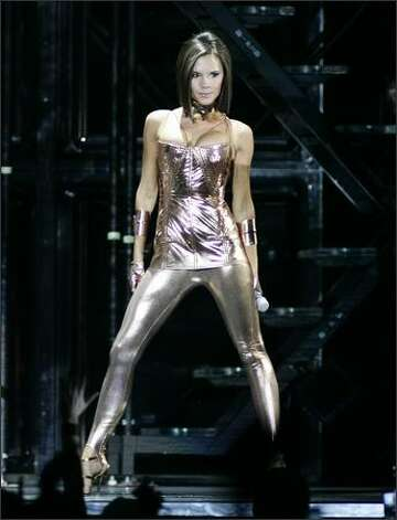 Spice Girls' Victoria Beckham performs with the group as they kick off their world tour at GM Place in Vancouver, on Dec. 2, 2007. Photo: Canadian Press