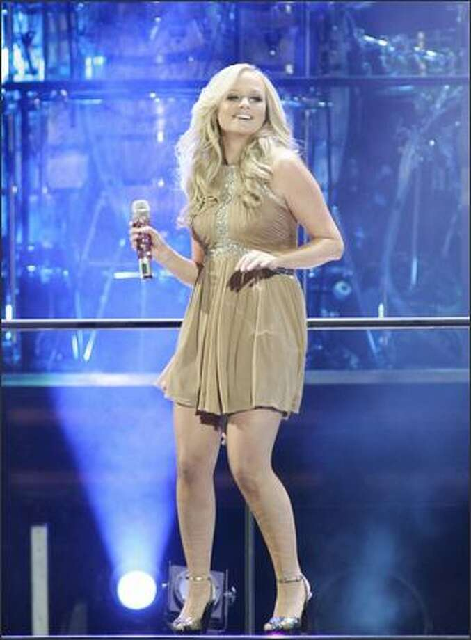 Spice Girls' Emma Bunton performs with the group as they kick off their world tour at GM Place in Vancouver, on Dec. 2, 2007. Photo: Canadian Press