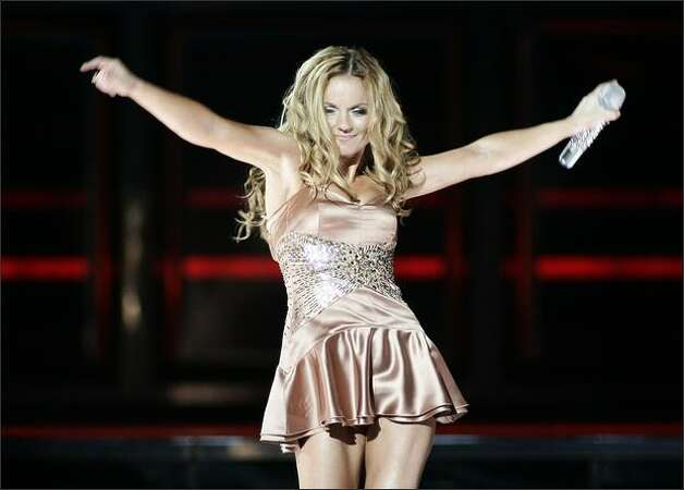 Spice Girls' Geri Halliwell performs with the group as they kick off their world tour at GM Place in Vancouver, on Dec. 2, 2007. Photo: Canadian Press