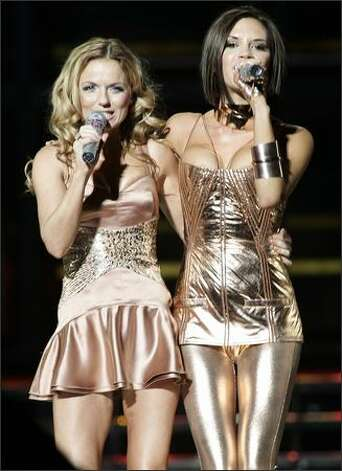 Spice Girls Victoria Beckham, right and Geri Halliwell perform with the group as they kick off their world tour at GM Place in Vancouver, on Dec. 2, 2007. Photo: Canadian Press