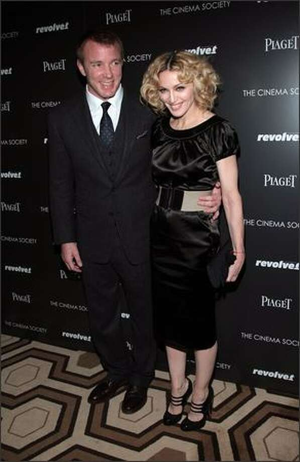 "Writer/director Guy Ritchie and musician Madonna attend a screening of ""Revolver"" hosted by the Cinema Society and Piaget at the Tribeca Grand Screening Room on Sunday in New York City. Photo: Getty Images"