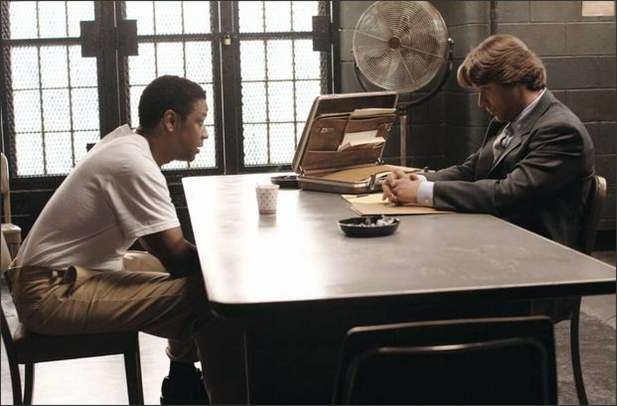 """Gangster Frank Lucas (Denzel Washington, left) discusses a deal with outcast cop Richie Roberts (Russell Crowe) in """"American Gangster,"""" nominated for best motion picture -- drama."""