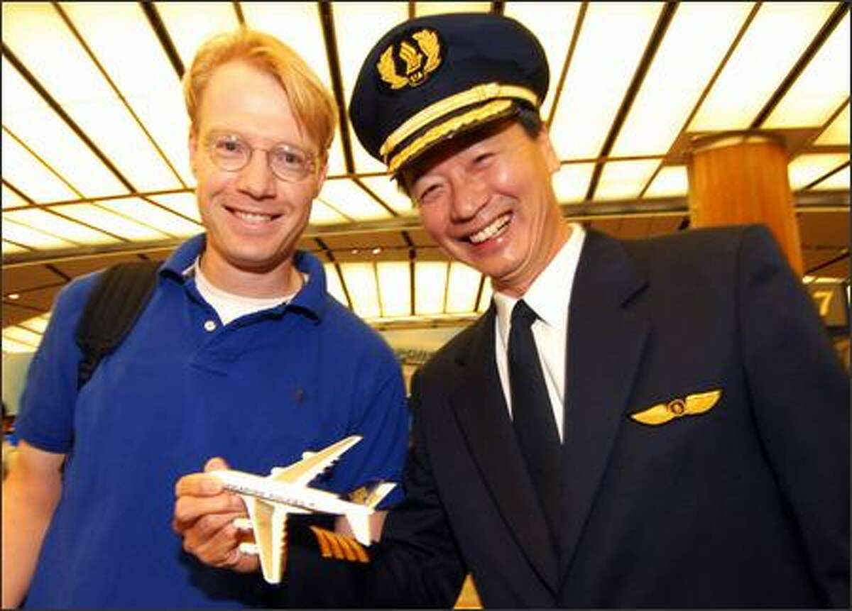 Dr. Franc Henze, an Australian surgeon set to board the airbus, poses with pilot Captain Robert Ting before the flight.