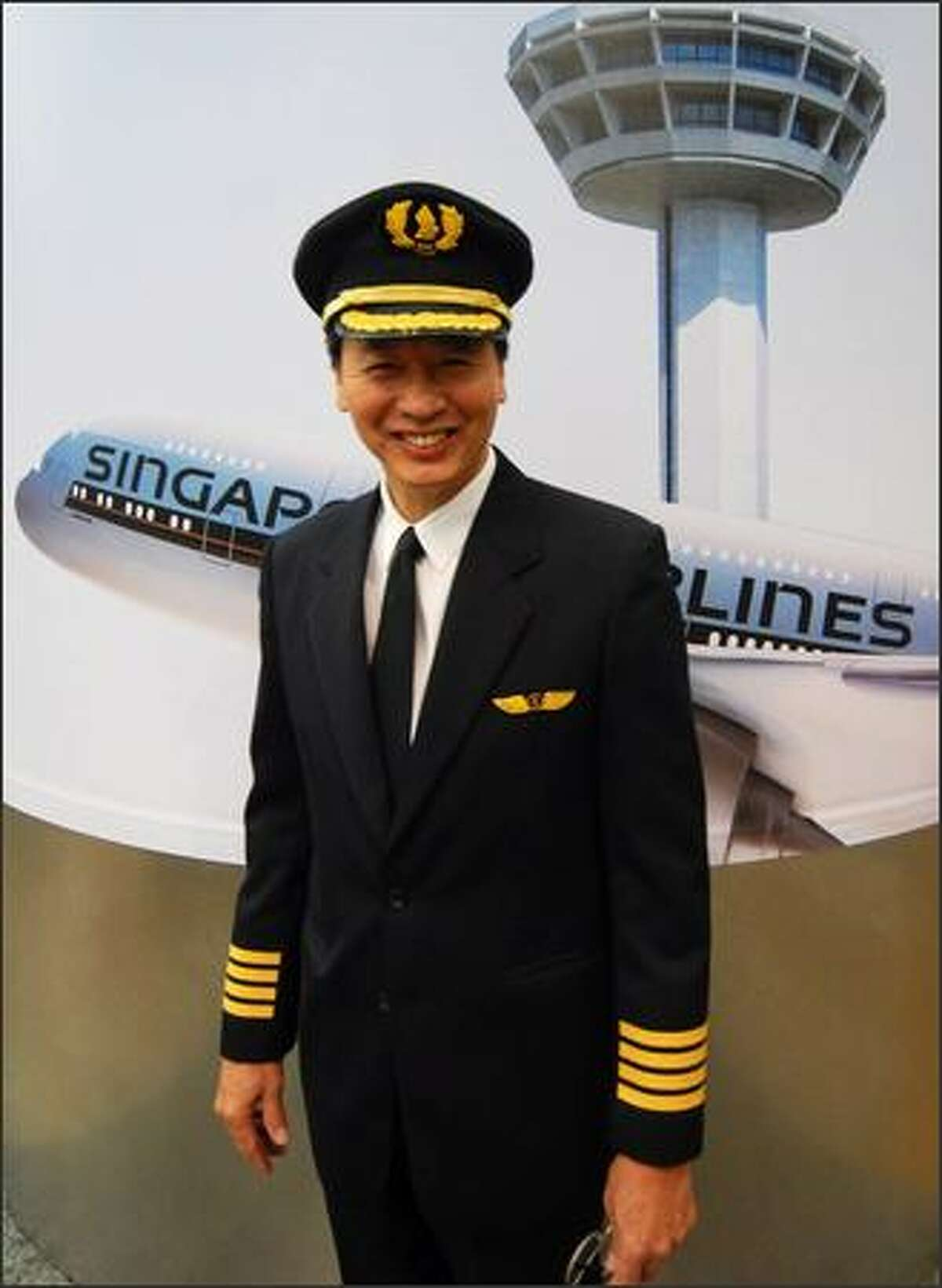 Captain Robert Ting poses for photographers before the maiden flight.
