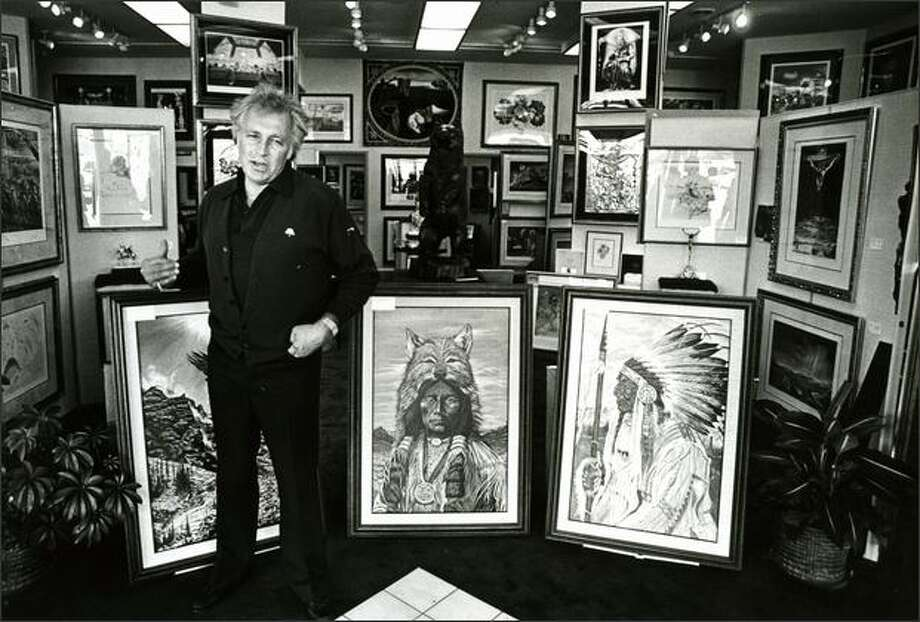 Bellevue, Wash. -- Evel Knievel, known for daredevil motorcycle jumps, leaped into the art world. He is shown here with some of the 23 paintings he has on display at an art gallery in this Seattle suburb, with Salvador Dali lithographs in the background, on Sept. 24, 1983. Photo: P-I File