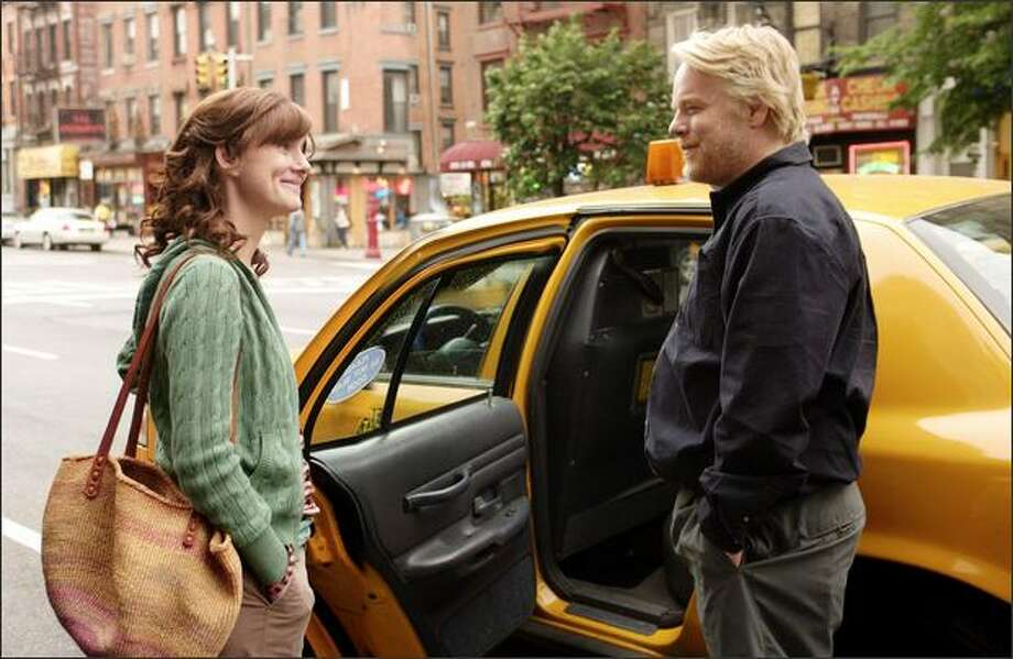 "Philip Seymour Hoffman got a nod for best performance by an actor in a motion picture -- musical or comedy, for his role in ""The Savages,"" here with co-star Laura Linney. Photo: Fox Searchlight Pictures"