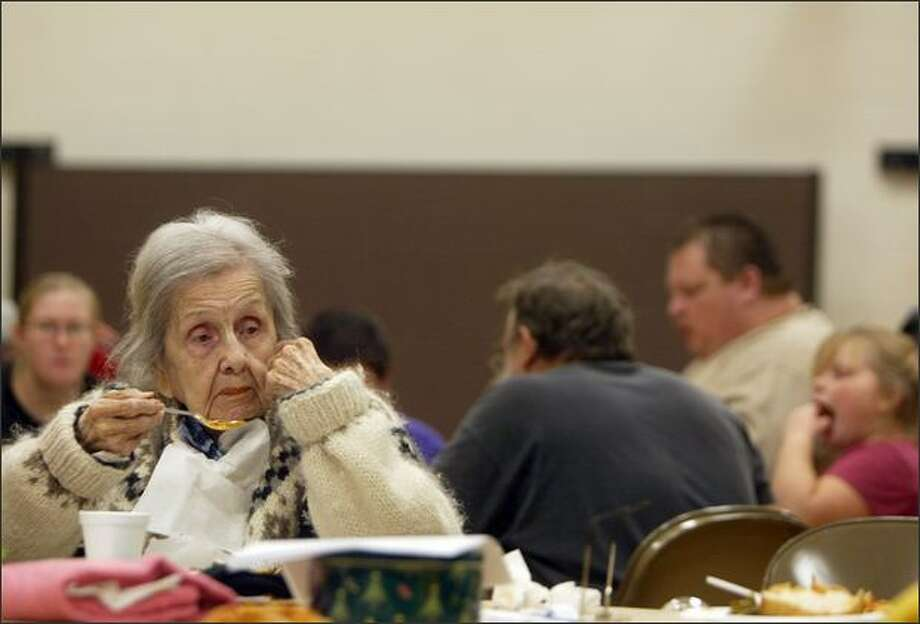 Adeline Richardson, 99, eats soup at The Church of Jesus Christ of Latter-Day Saints in Centralia, Wash. Richardson is staying at the church, which has become a shelter for flood victims, after being evacuated from Olympic Health Care, a nursing home in Centralia. The shelter plans on housing 30-40 people. Photo: Mike Kane, Seattle Post-Intelligencer