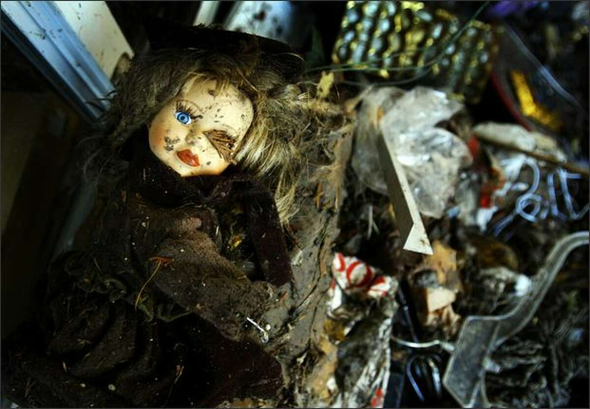 A doll sits atop a pile of destroyed household items at an apartment building on Midvale Avenue North in Seattle after flooding inundated the neighborhood earlier in the week.