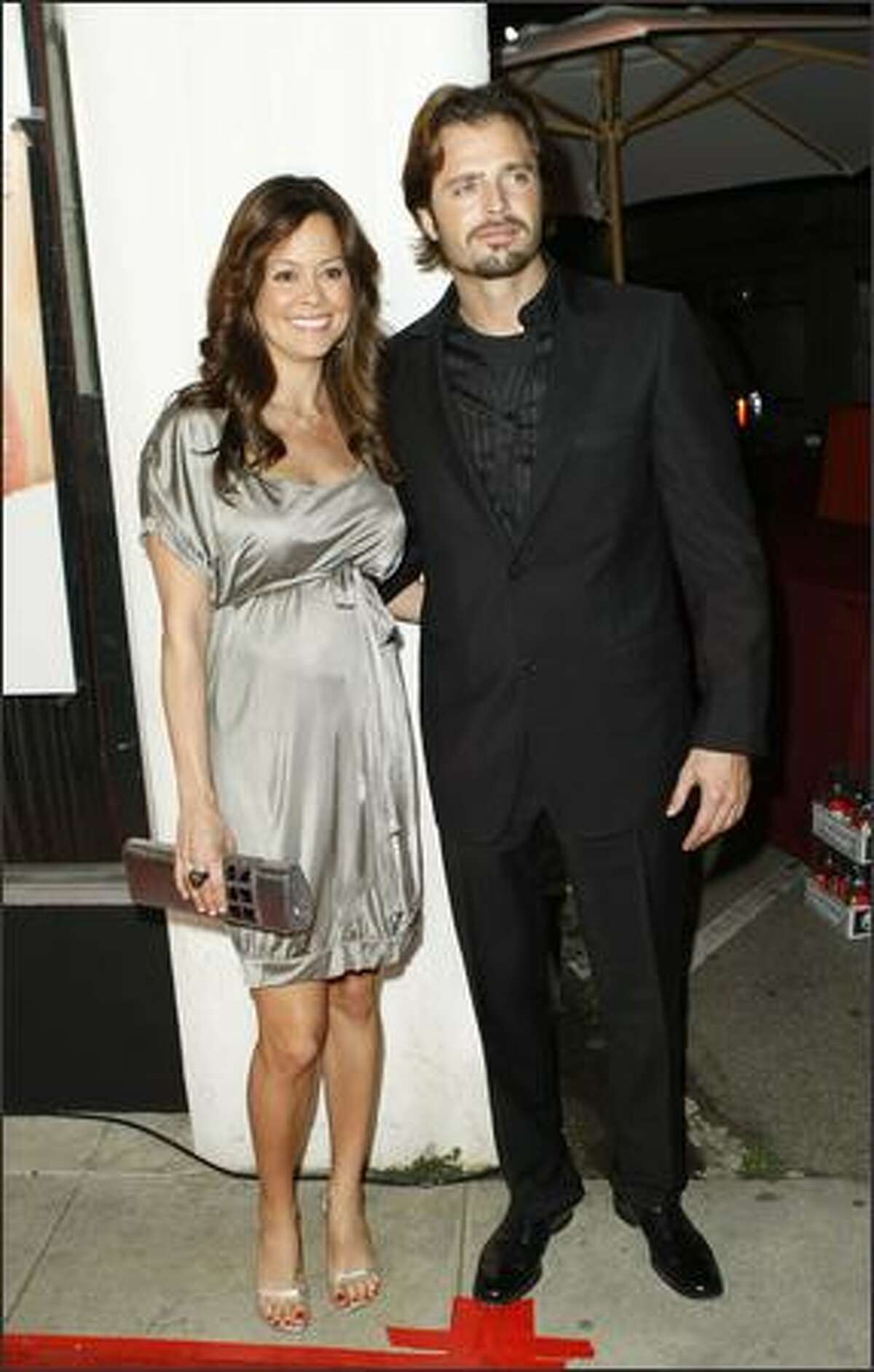 Actress Brooke Burke (L) and actor David Charvet arrive at the premiere of