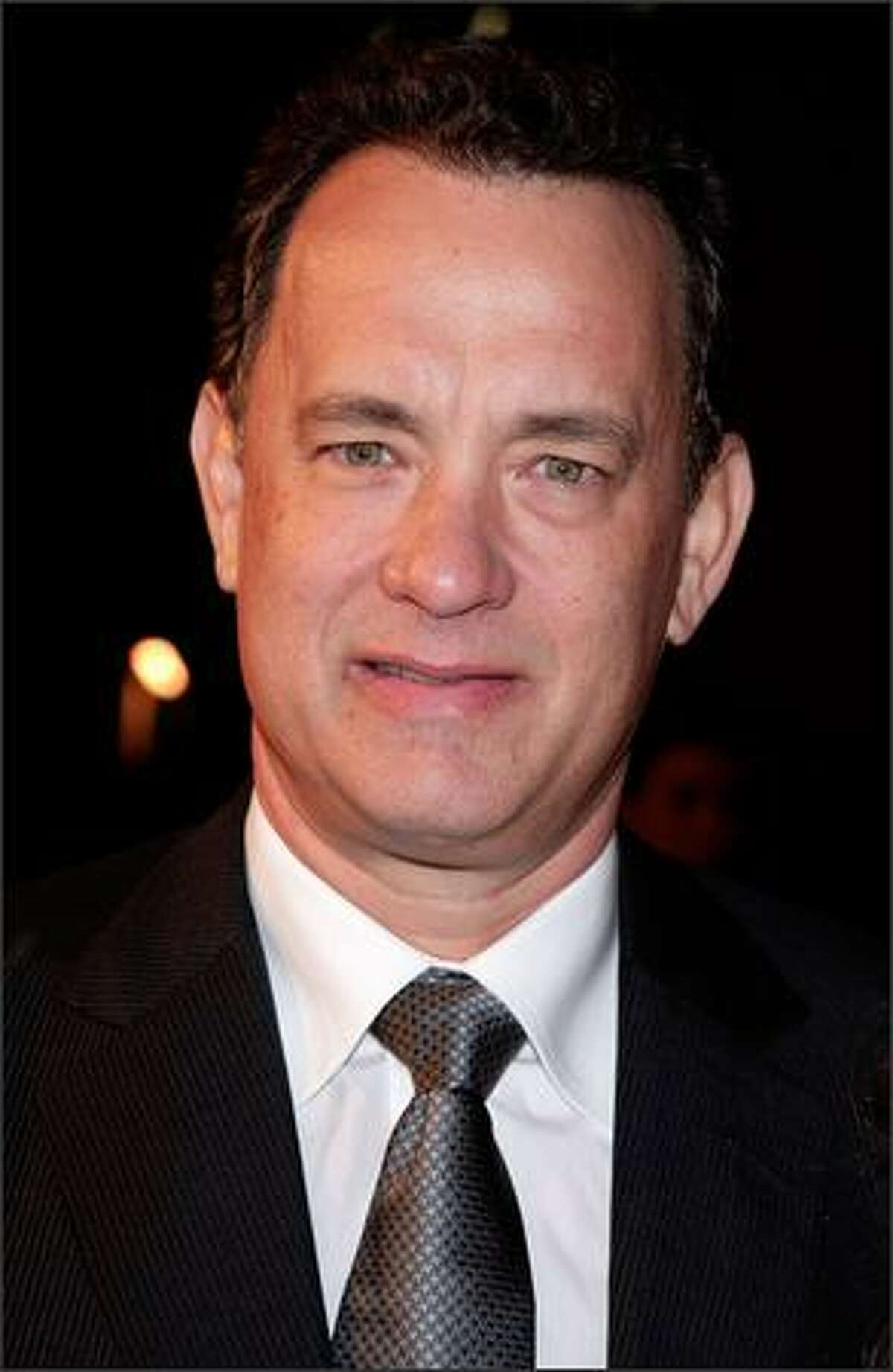 """Actor Tom Hanks arrives at the Universal Pictures' premiere of """"Charlie Wilson's War"""" held at CityWalk Cinemas on Monday in Los Angeles, Calif."""