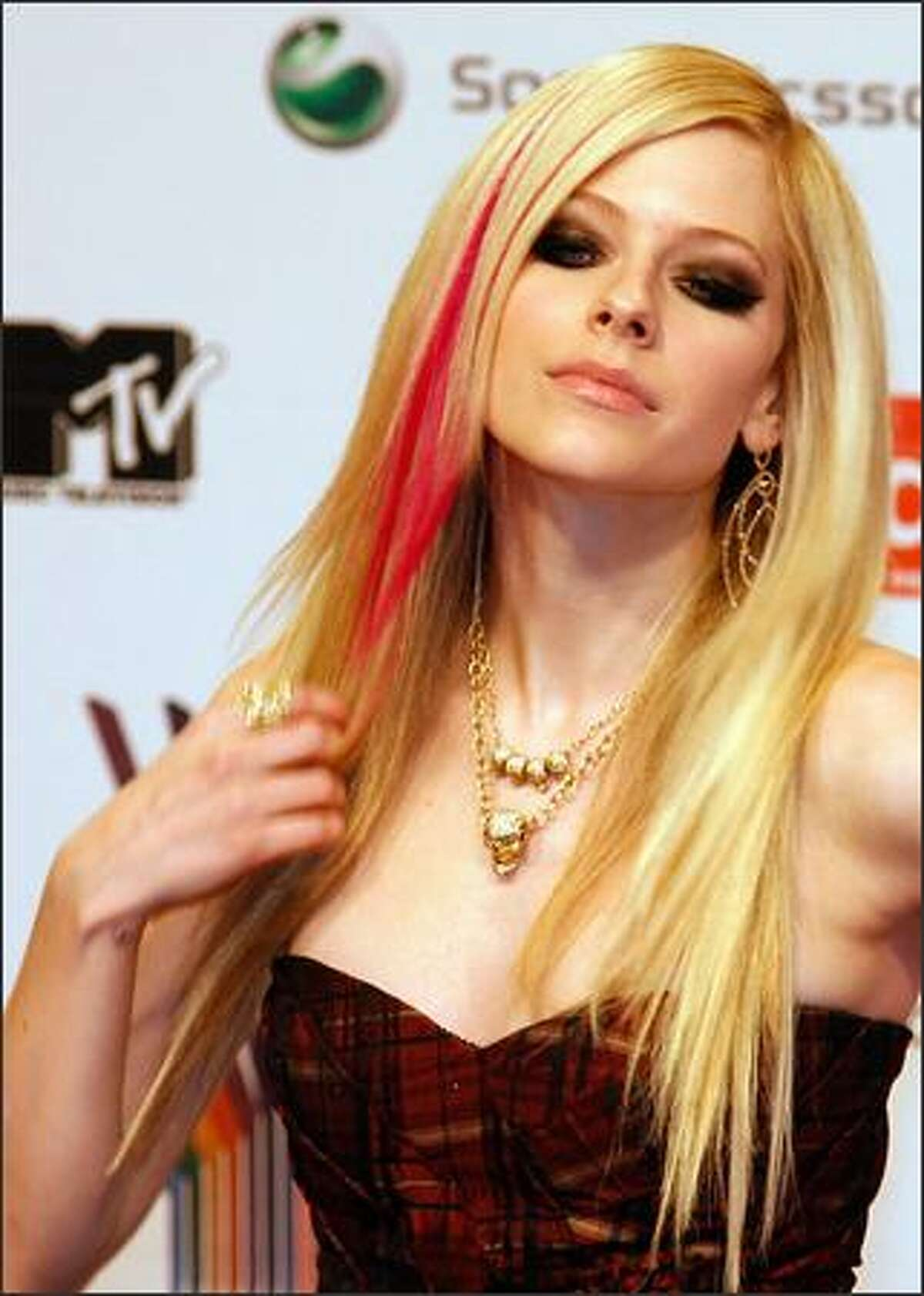 Canadian singer Avril Lavigne poses for photographers as she arrives for the MTV Europe Music Awards.