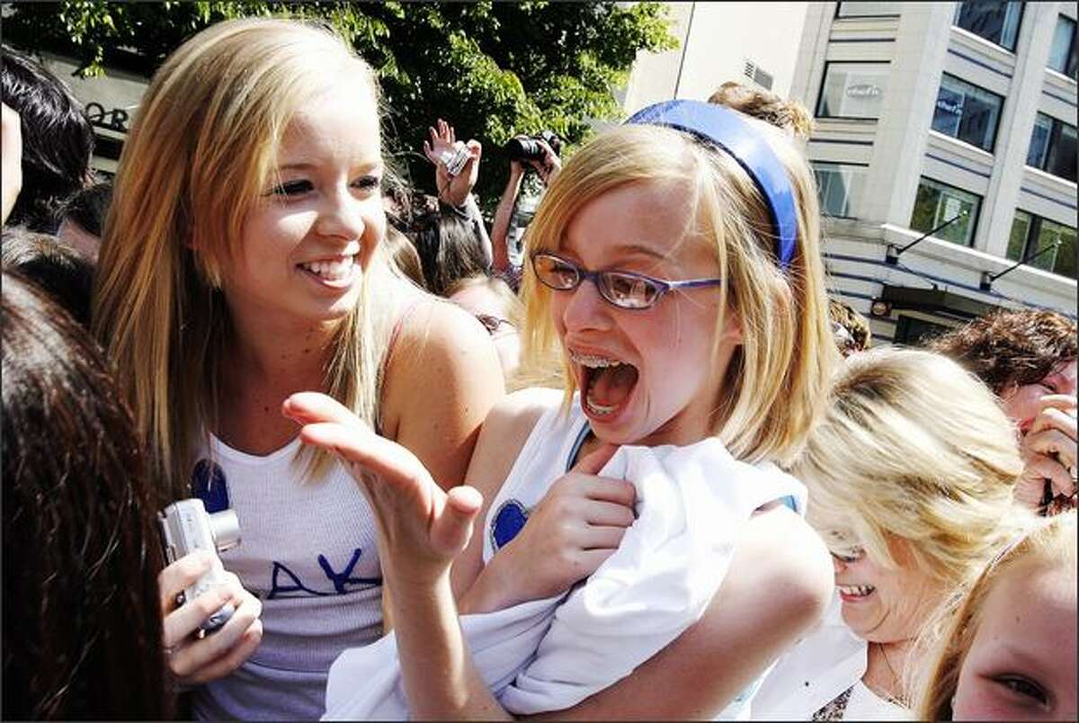 Ingrid Garberg, 16, left, and sister Greta, 12, totally freak out after touching Blake Lewis as he walks by them after performing at Seattle's Westlake Center on Friday. The girls came with their mother and aunt from Kent to get a glimpse of Lewis, one of the top three contenders on