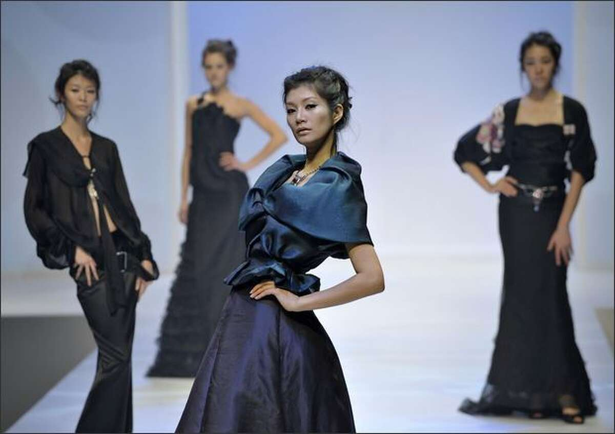 A model showcases designs on the catwalk at the Supreme Corea Artist I show by designer Ahn Yoon Yung of the Korean Women Entrepreneurs Association on the second day of Hong Kong Fashion Week Autumn/Winter 2008, at Hong Kong Convention & Exhibition Centre (HKCEC) on Tuesday in Hong Kong, China.