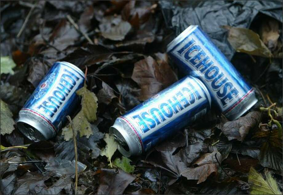 Beer cans litter the hillside where a homeless encampment is located in the hills just north of 1170 Elliott Ave. Photo: Gilbert W. Arias, Seattle Post-Intelligencer