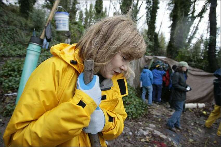 Patricia McInturff, Director of the City of Seattle Human Service Department during a recent media tour of a homeless encampment located in the hills just north of 1170 Elliott Ave.