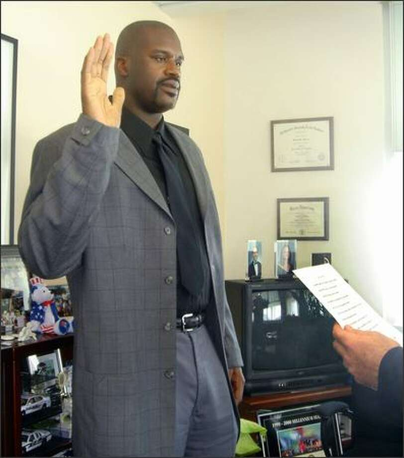 An interaction with anyone with a badge and a gun would get us to stand up straight and focus. But make the fella with badge and gun 7-foot-1 Shaquille O'Neal (who was sworn into the Miami Beach, Fla., Police Department as a reserve officer Thursday) and we're more likely to play by the rules. Why? His bigness ... it scares us. Photo: AP