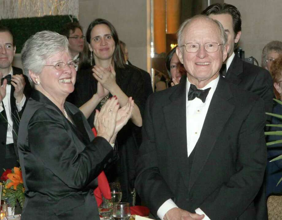 Dr. Thomas Older, right, is applauded by his wife, Anne, left, and other members of his family before being presented with the American Heart Association's inaugural Heart Hero Award during Hearts on Fire. Dr. Older performed Albany's first coronary bypass surgery in 1970, and developed the cardiothoracic field in the Capital Region. Saratoga Springs, N.Y., March 5, 2011 (Photo by Joe Putrock/Special to the Times Union) Photo: Joe Putrock / Joe Putrock