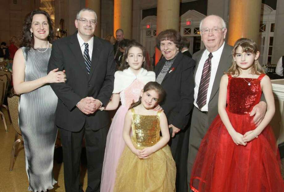 Left to right: Kim and Jeff Sova, Haley Sova, Marie Sova, Marylou and Donald Hall, and the 2011 Heart Princess Chloe Sova during Hearts on Fire, the American Heart Association's 28th Annual Capital Region Heart Ball in Saratoga Springs, N.Y., on March 5, 2011. (Photo by Joe Putrock / Special to the Times Union) Photo: Joe Putrock / Joe Putrock