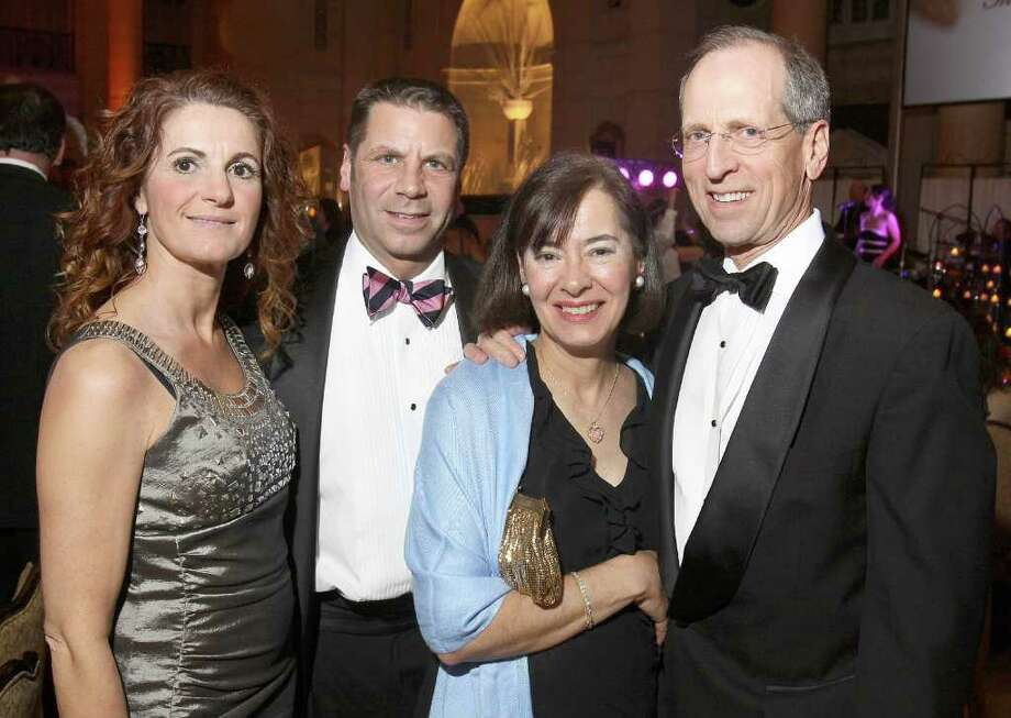 Left to right: Marie Semenza, St. Peter's Hospital Foundation Executive Director Peter Semenza, Rosemarie Boyle and St. Peter's Hospital Pesidant and CEO Steven Boyle during Hearts on Fire, the American Heart Association's 28th Annual Capital Region Heart Ball in Saratoga Springs, N.Y., on March 5, 2011. (Photo by Joe Putrock / Special to the Times Union) Photo: Joe Putrock / Joe Putrock