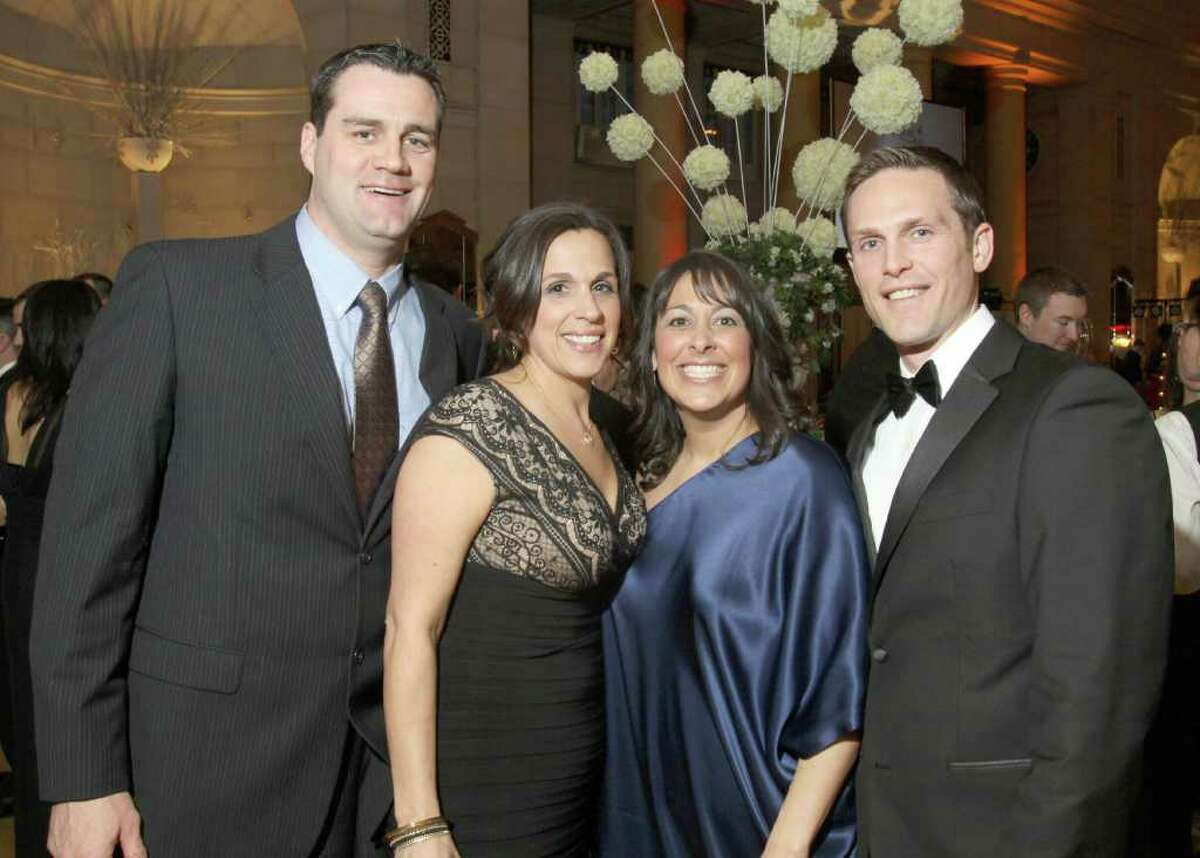 Left to right: Jason and Stacie Graber, and Holly and Eric Minkiewicz during Hearts on Fire, the American Heart Association's 28th Annual Capital Region Heart Ball in Saratoga Springs, N.Y., on March 5, 2011. (Photo by Joe Putrock / Special to the Times Union)