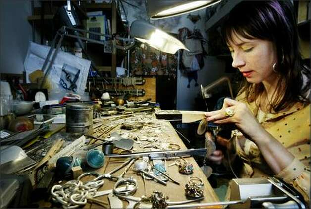 Jana Brevick has been cited in Metalsmith magazine as one of the six most progressive jewelry artists in the United States. She studied fashion and jewelry design before returning to the University of Washington in the 1990s for a degree in metal design. Photo: Dan DeLong/Seattle Post-Intelligencer