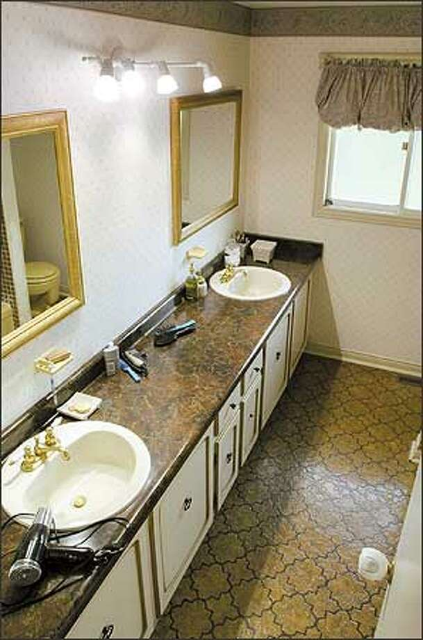 Try squeezing a family of four into this cramped bathroom. Photo: / HGTV