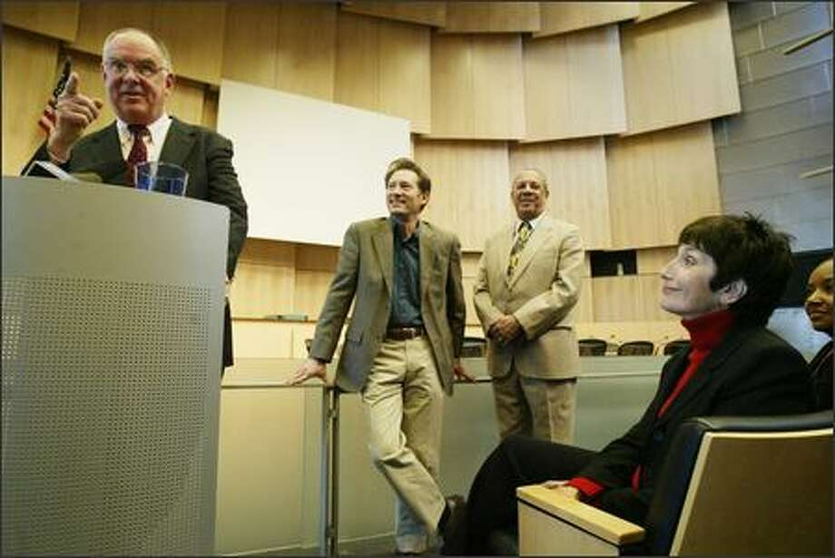 Jim Compton announces his retirement. His wife, Carol Arnold, and Councilmen Peter Steinbrueck, center left, and Richard McIver look on. Photo: Dan DeLong/Seattle Post-Intelligencer