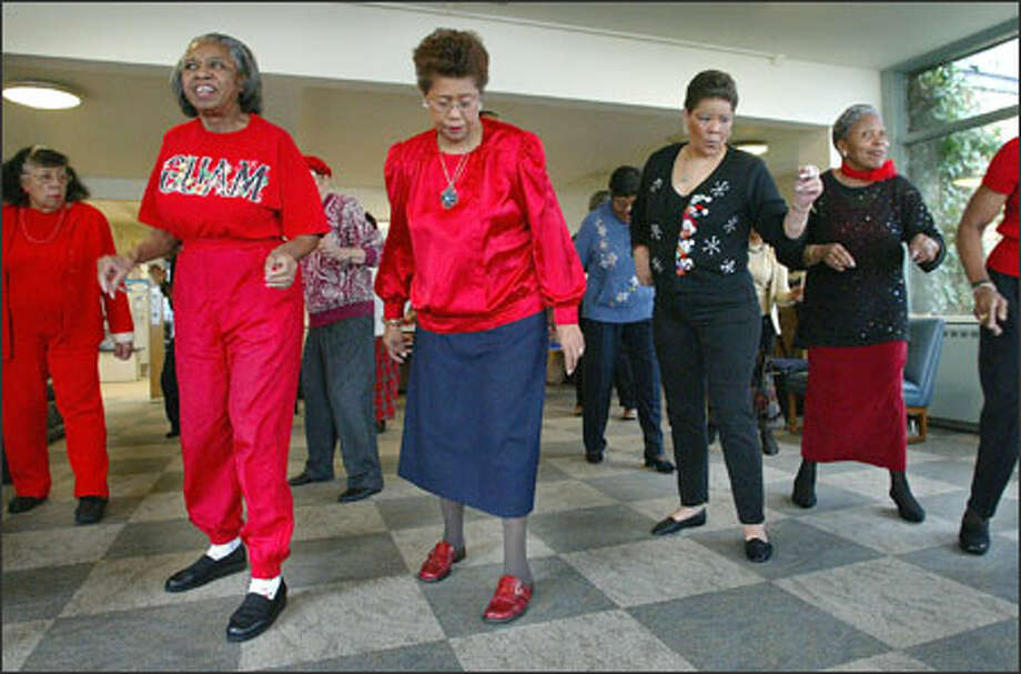 Members of the Sliders dance group work it before their Christmas party Tuesday at the Central Area Senior Center. The front row, from left: Callie Rheubottom, Melvina Jones, Jakie Baird and Evalena Hatcher. The center had been facing closure but received a reprieve until next year. Photo: Gilbert W. Arias/Seattle Post-Intelligencer / Seattle P-I