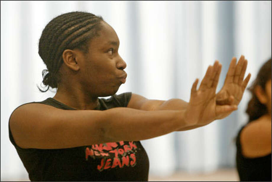 """Shundra King, shown performing a hip-hop dance Dec. 13 at a talent show, says that without New Futures, """"I wouldn't have any of the goals I have today. I would be lost."""" Photo: Dan DeLong/Seattle Post-Intelligencer"""