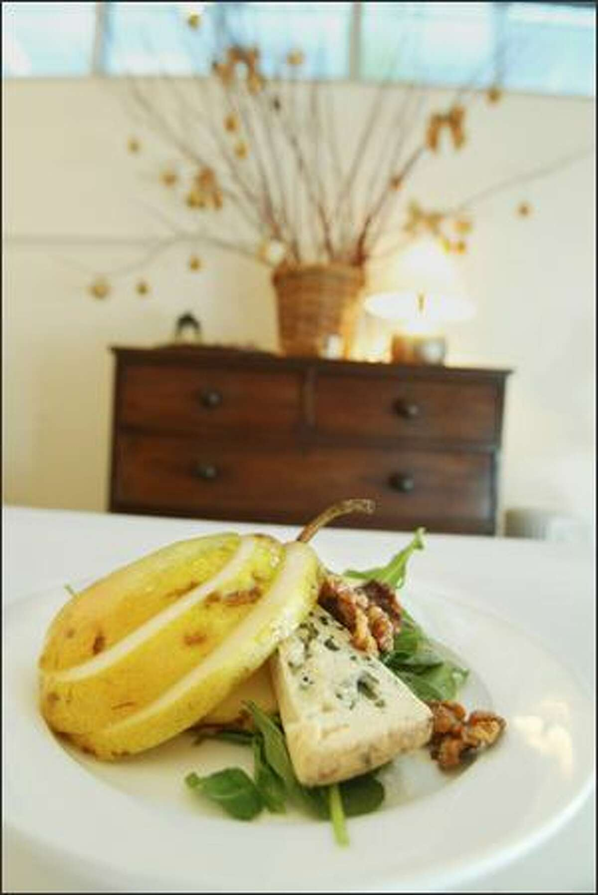 Erickson cuts pears into loose rounds for this mixed-green salad with bleu d'auvergne cheese and roasted walnuts.