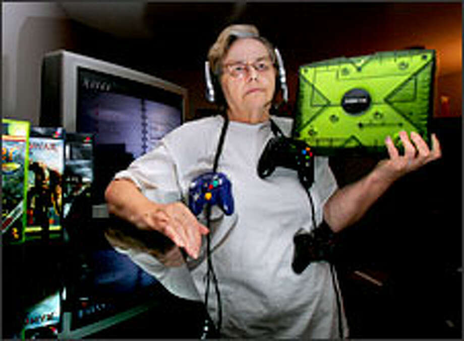 """Microsoft's Xbox gets an unlikely boost in this photo of the """"grandma gamer"""" soon to be seen reviewing vid games on MTV. Barbara St. Hilare, a 69-year-old gamester from Ohio, admits to 10 hours of daily gaming, putting down a goodly portion of her Social Security check from Uncle Sam to support her habit. Photo: PHIL MASTURZO/AKRON BEACON JOURNAL/AP"""