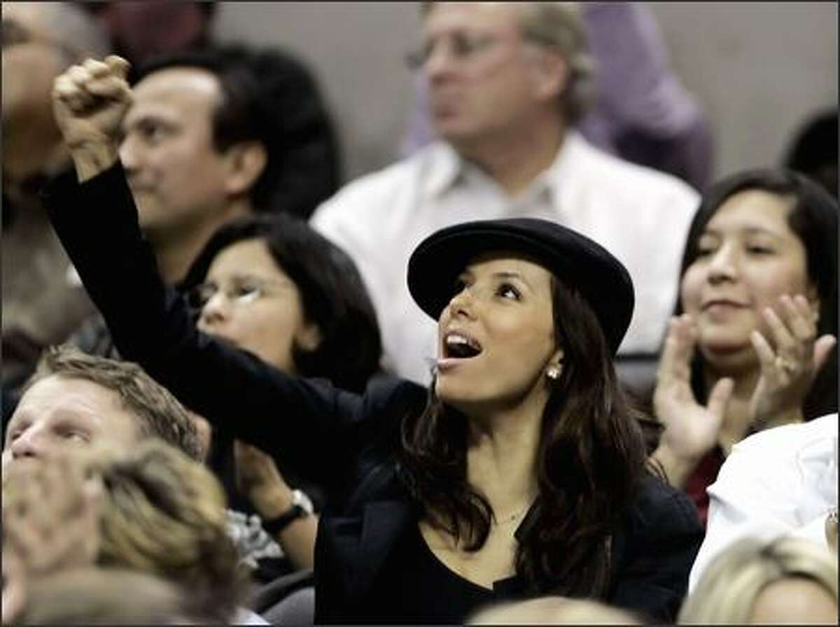 Eva Longoria of Desperate You-Know-Whats cheers on her NBA beau, Spurs guard Tony Parker, during a Spurs-Pacers tilt Tuesday eve in San Antonio. Longoria's luscious puss shows no obvious stress lines following last weekend's encounter with Alamo City police during a late-night traffic stop of Parker's wheels.