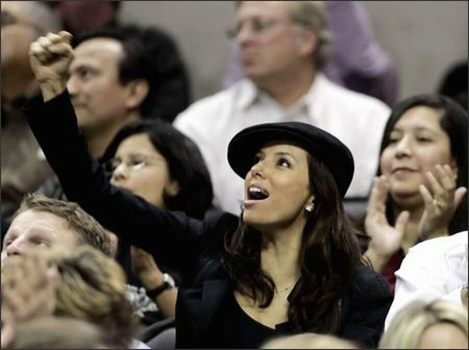 Eva Longoria of Desperate You-Know-Whats cheers on her NBA beau, Spurs guard Tony Parker, during a Spurs-Pacers tilt Tuesday eve in San Antonio. Longoria's luscious puss shows no obvious stress lines following last weekend's encounter with Alamo City police during a late-night traffic stop of Parker's wheels. Photo: ERIC GAY/AP