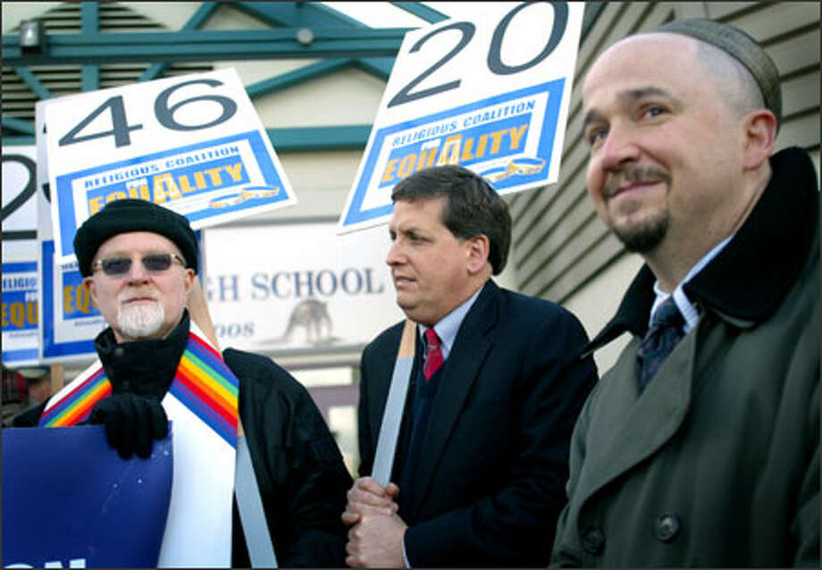 From left, Pastor Craig Darling of Seattle First Baptist Church, Rabbi Jonathan Singer of Temple Beth Am and Cantor David Serkin-Poole of Temple B'nai Torah demonstrate for gay rights Wednesday in Kirkland at the site where Antioch Bible Church meets on Sundays. Last year, the church opposed a state bill that would have outlawed discrimination on the basis of sexual orientation. The bill is expected to be introduced again this year. Photo: Joshua Trujillo/Seattle Post-Intelligencer / Seattle Post-Intelligencer
