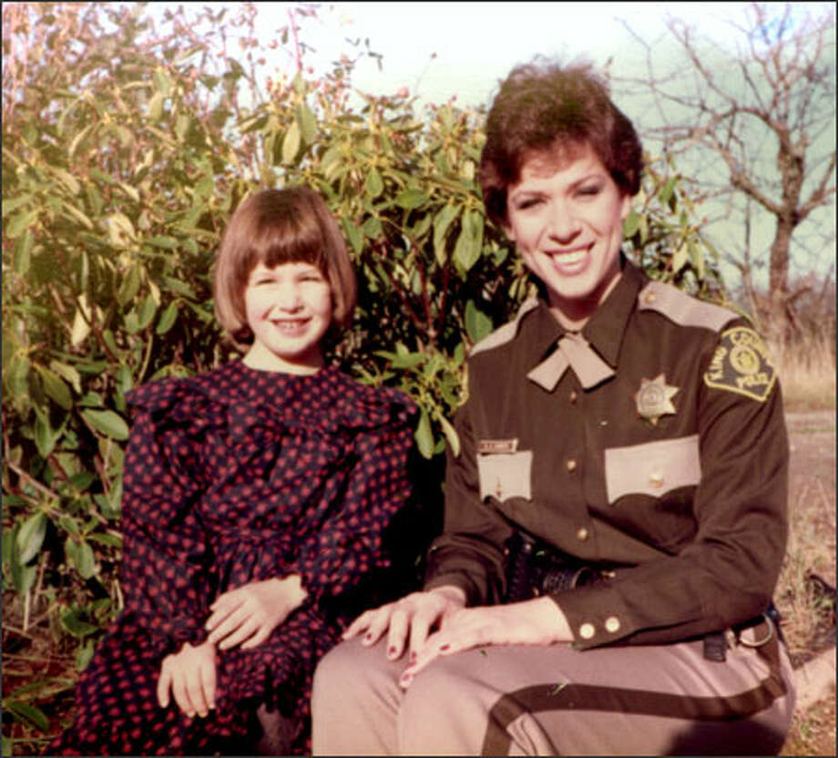 Former King County Deputy Kathy Svinth and her daughter, Trina, pictured early in Svinth's law enforcement career in the mid-1980s. Svinth says a culture within the Sheriff's Office that fosters favoritism and a lack of accountability complicated a sexual- abuse investigation of her former husband and fellow King County Deputy William Erdt, in which he was accused of abusing her daughter. Photo: /Family Photo