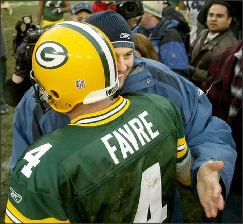 Packers quarterback Brett Favre, who might have played his final game for Green Bay, meets ex-teammate Matt Hasselbeck following the Packers' win. Photo: Scott Eklund/Seattle Post-Intelligencer
