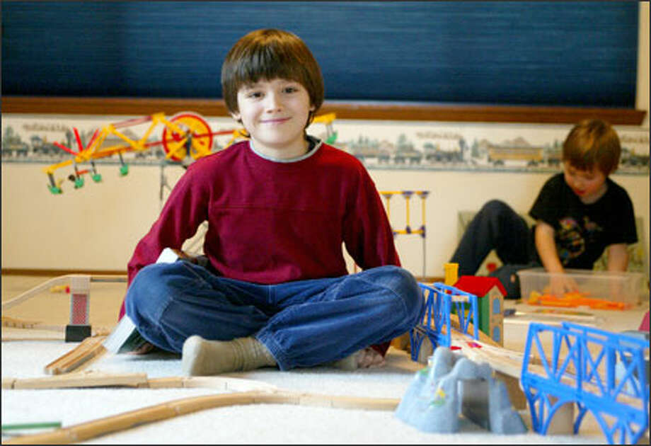 Aidan Gold, with his brother, Janick, at their Bothell home. Photo: Paul Joseph Brown/Seattle Post-Intelligencer