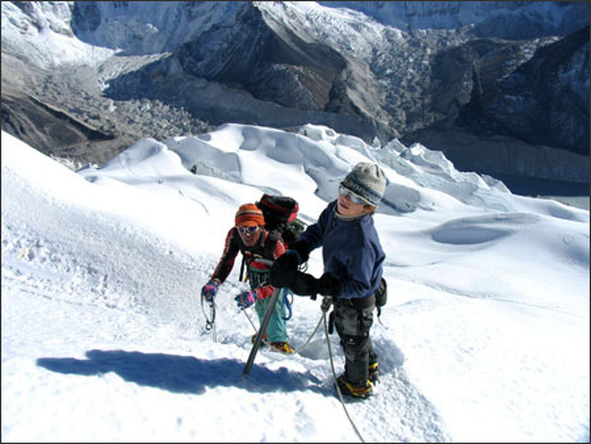 On Nov. 10, Aidan Gold, 8, of Bothell climbed 20,300-foot Island Peak in the Himalayas. At left is climbing Sherpa Namgye Sherpa. Aidan's father, Warren Gold, took the picture.